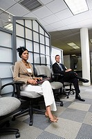 Man and woman sitting in an office waiting area