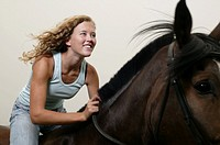 Teenage girl 16-17 riding horse