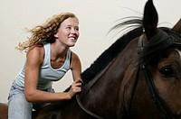 Teenage girl 16-17 riding horse