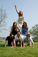 Friends performing human pyramid in park