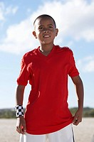 Boy 10-11 in sport clothing outdoors