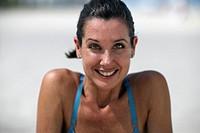 Mature woman outdoors, smiling, portrait, close-up