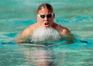 Male swimmer doing breaststroke