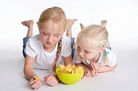 Two blond girls eating chips (thumbnail)