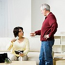 Mature couple discussing money at home