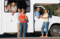 Family of three generations by motor home, smiling, portrait