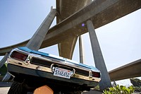 Car beneath overpasses, low angle view lens flare