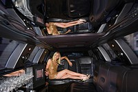 Young woman in limousine, legs crossed