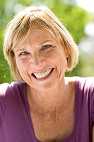 Mature woman oudoors, smiling, portrait (thumbnail)