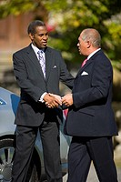Businessman and colleague shaking hands outdoors
