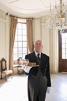 Butler with tray of drinks, portrait (thumbnail)