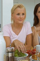 Two women at breakfast table (thumbnail)