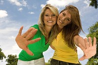 Happy portrait of young women reaching (thumbnail)