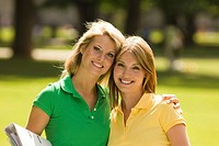Happy portrait of young women holding folders outdoors (thumbnail)