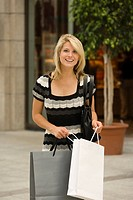 Young woman carrying shopping bags (thumbnail)