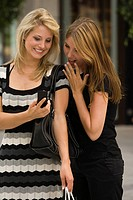 Young women looking at cell phone (thumbnail)