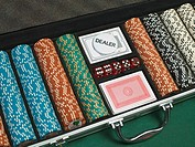 Detail of poker chips, playing cards, and dice