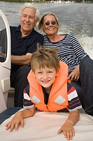 Grandparents and grandson on boat (thumbnail)
