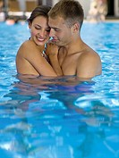 Affectionate couple in pool (thumbnail)