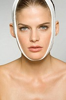 Portrait of a young woman with bandage around her head (thumbnail)