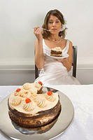 Bride eating wedding cake (thumbnail)