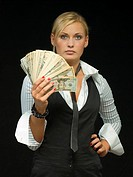 Woman holding a wad of cash