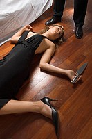 Woman's dead body on floor holding knife
