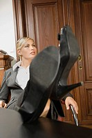 Businesswoman with her feet up (thumbnail)