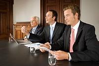 Businessmen in board meeting