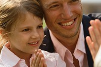 Close-up of a girl smiling with her father