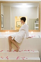 Woman sitting next to bubble bath (thumbnail)