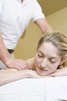 Woman receiving massage (thumbnail)