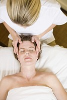 Woman receiving facial massage (thumbnail)