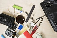 Contents of woman&#198;s purse on table