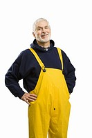 Senior male fisherman with hands on hips