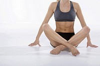 Woman in athletic gear sitting cross-legged