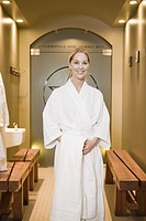 Woman in bathrobe a spa