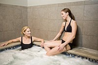 Two women sitting in hot tub