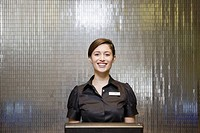 Female hotel front desk clerk