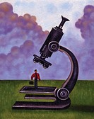 Businessman standing underneath a microscope