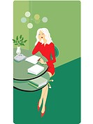 Businesswoman sitting at her desk and writing a report (thumbnail)