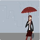 Businesswoman standing under an umbrella in the rain
