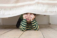 Boy playing hide and seek