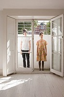 Young couple standing in a doorway