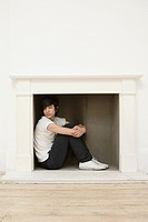 Man sitting in a fireplace