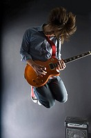 A guitarist jumping