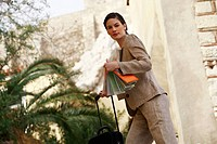 Businesswoman with a map and suitcase (thumbnail)