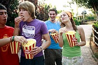 Teenagers hanging out eating popcorn