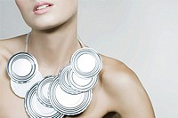 A woman wearing a tin can necklace