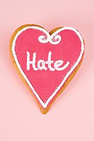 Hate written on heart shaped candy